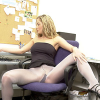 Secretary in stockings masturbates at her desk