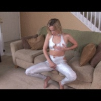 Blondie plays with herself in tight shiny silver outfit