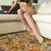 Bernice in black lingerie strips for your sexual pleasure