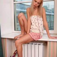 Cindy exposes smooth legs and wears no panties by the window