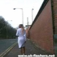 Hot blonde MILF getting naked in the UK streets