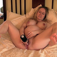 A heavily pregnant Tinkerbell has some fun with her now huge boobs and her big hair brush